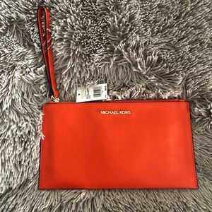 Michael Kors Large Zip Wristlet in Clementine